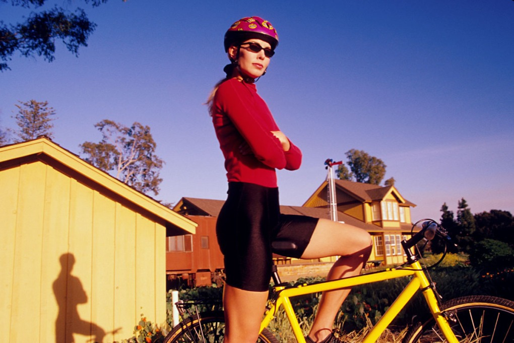 portrait of a confident young woman on a bicycle
