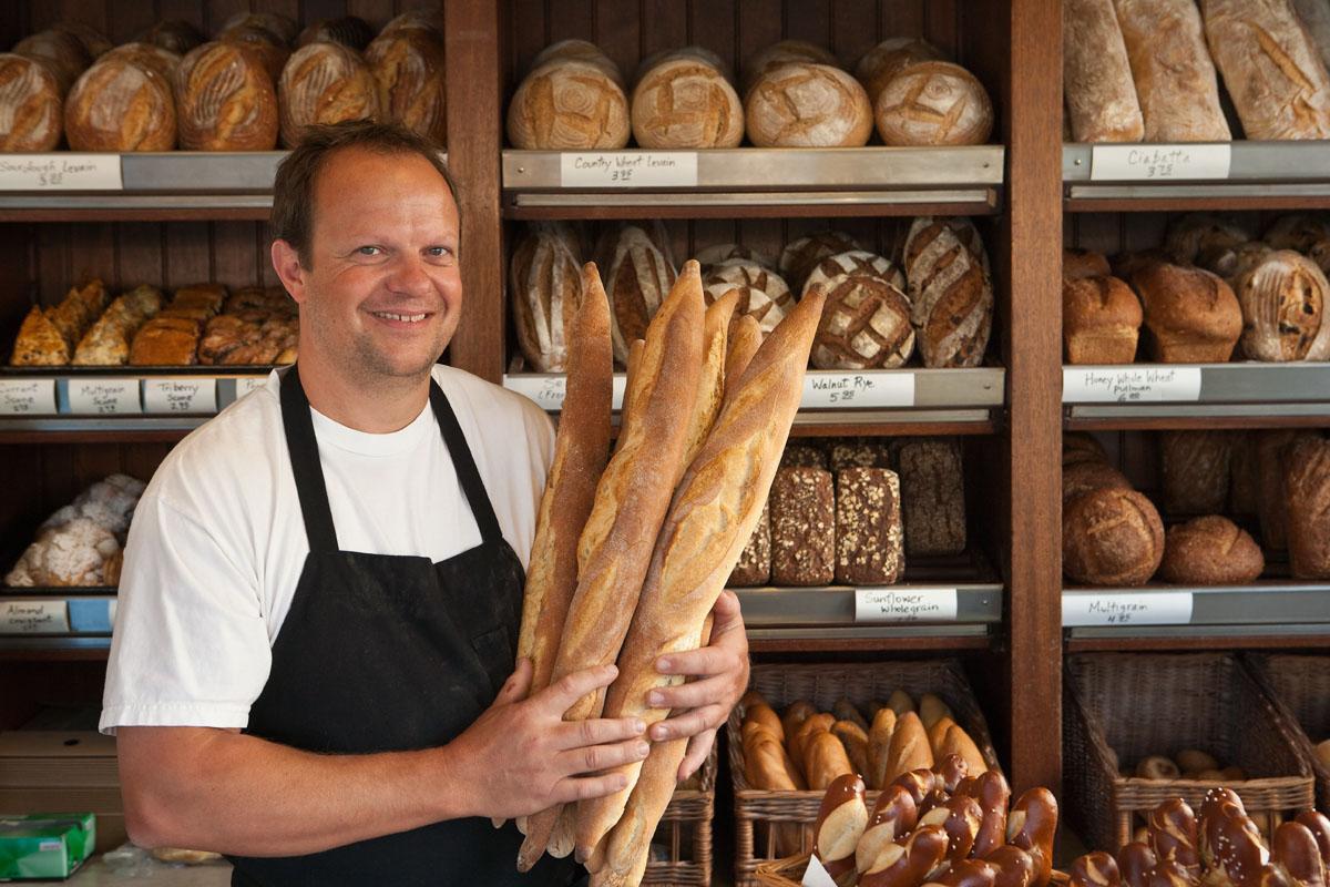 portrait of a baker holding bread