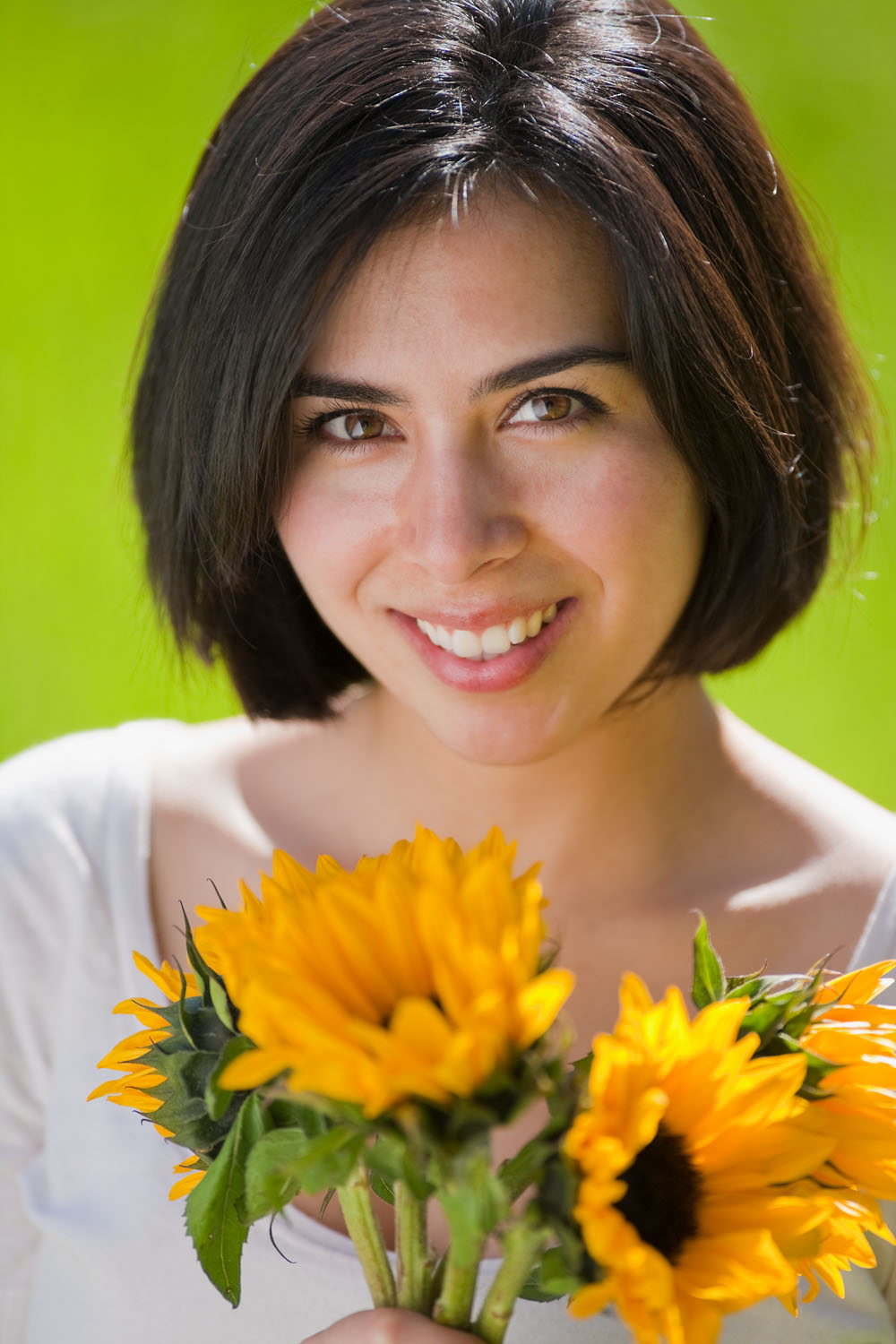 Portrait of young Hispanic woman with flowers