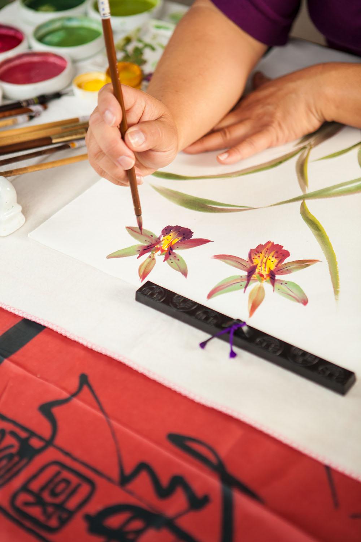 collector paints orchids