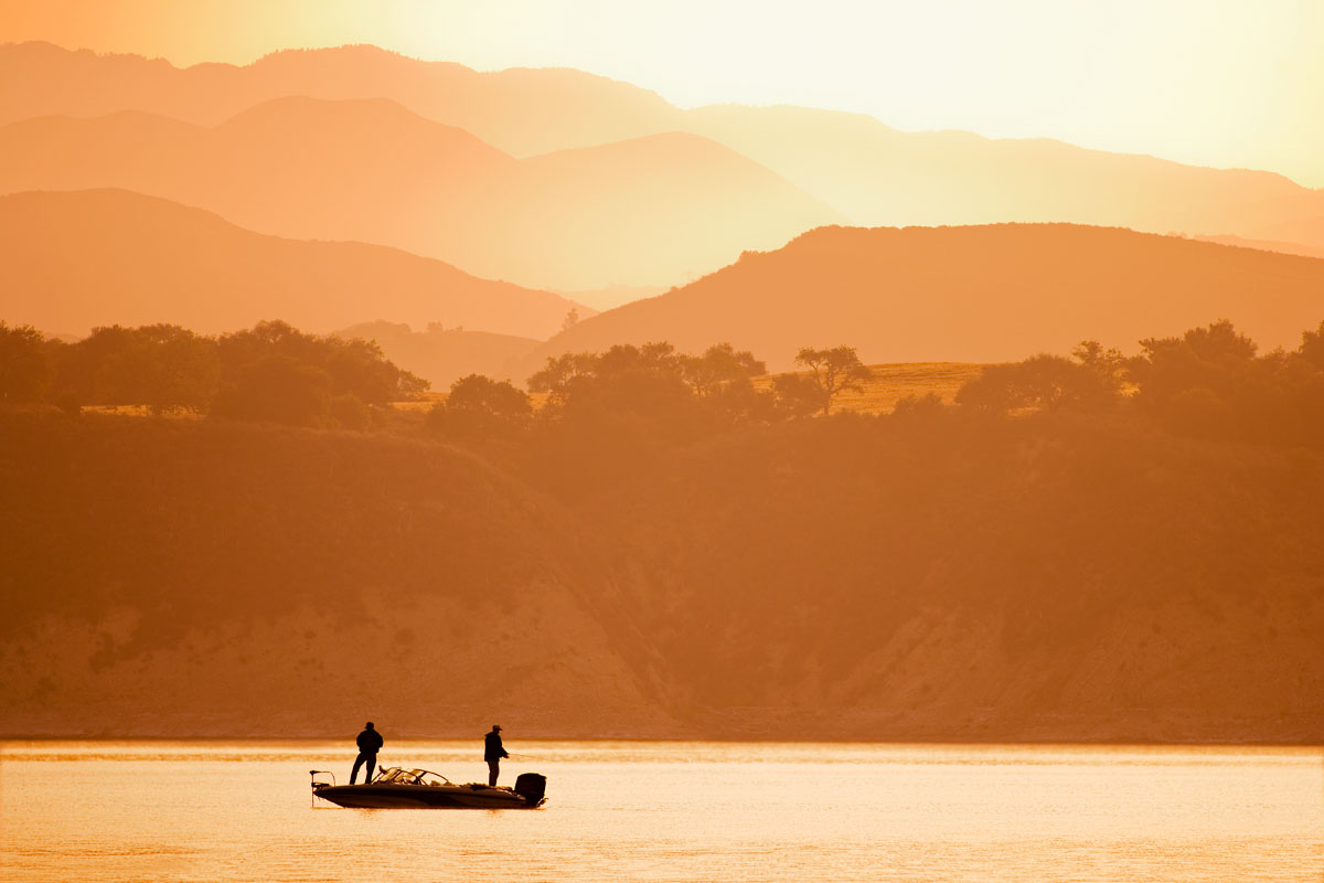 Focus stacked photo of bass fishermen on a lake.