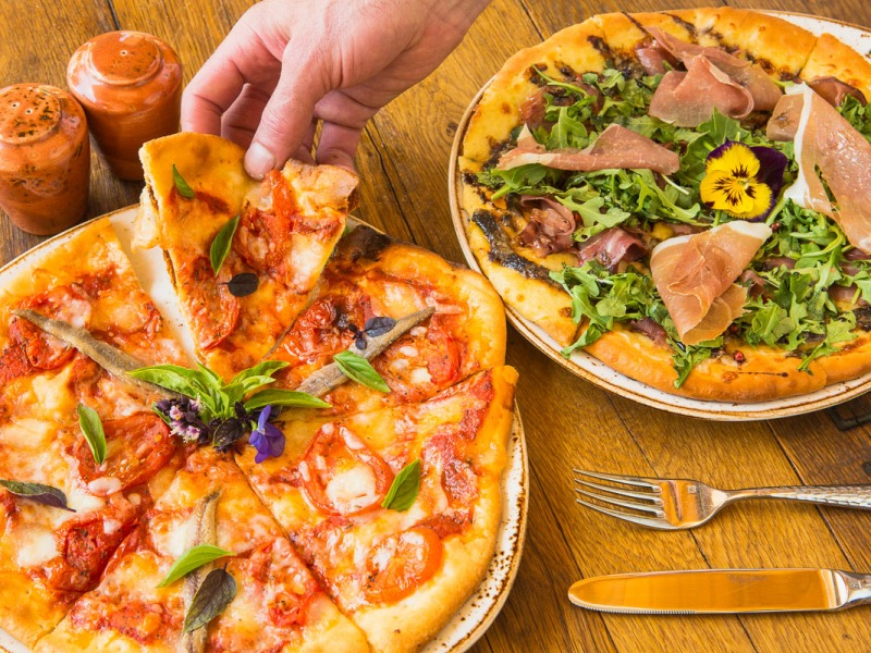 Pizzas with hand for prop