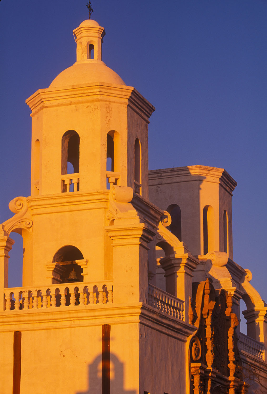 Mission San Xavier del Bac sidelit by the setting sun