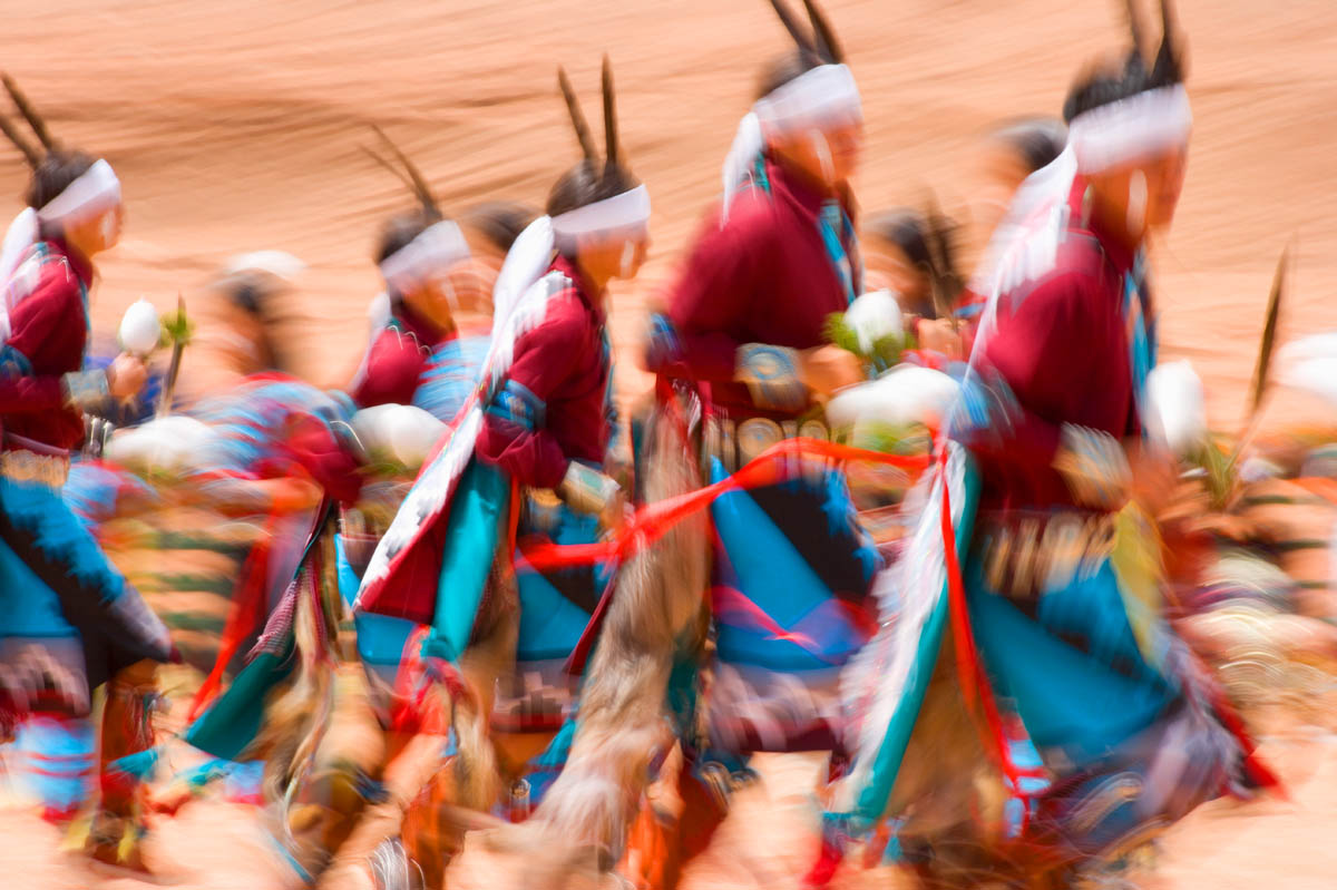 1/15 second exposure blurs Navajo Gourd Dancers.