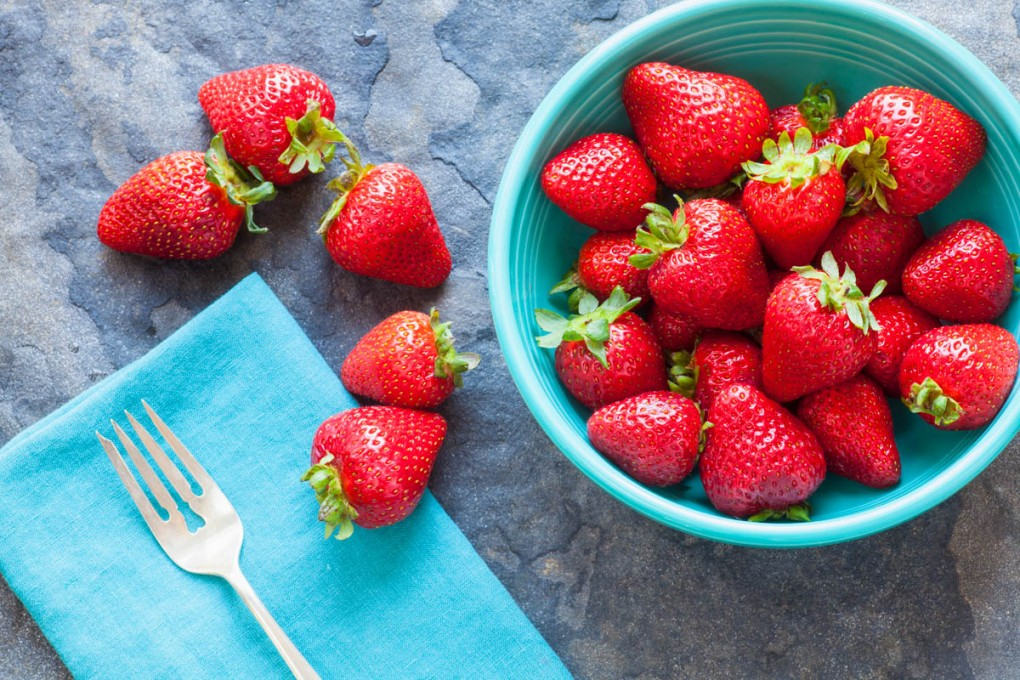 bowl of summer strawberries photographed from above
