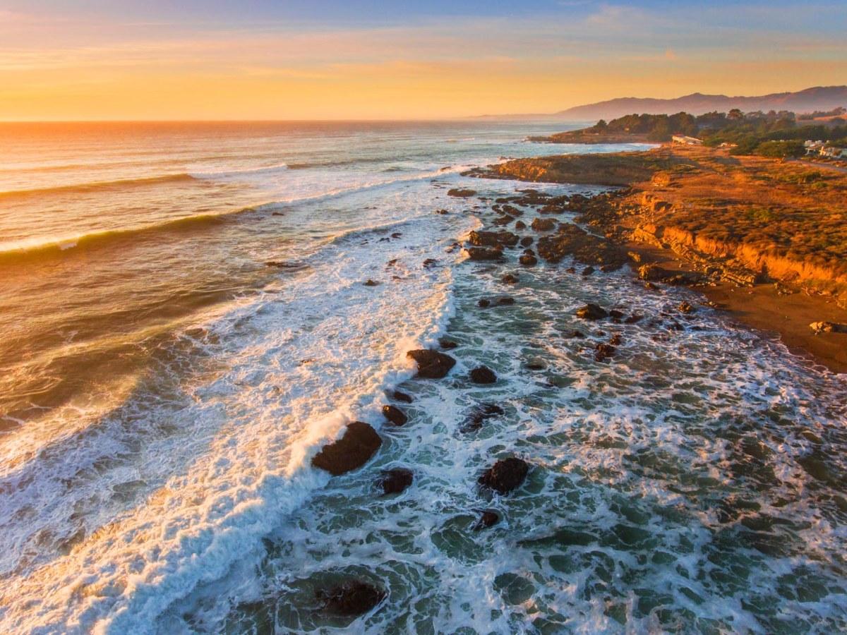 medium altitude aerial of coastal sunset