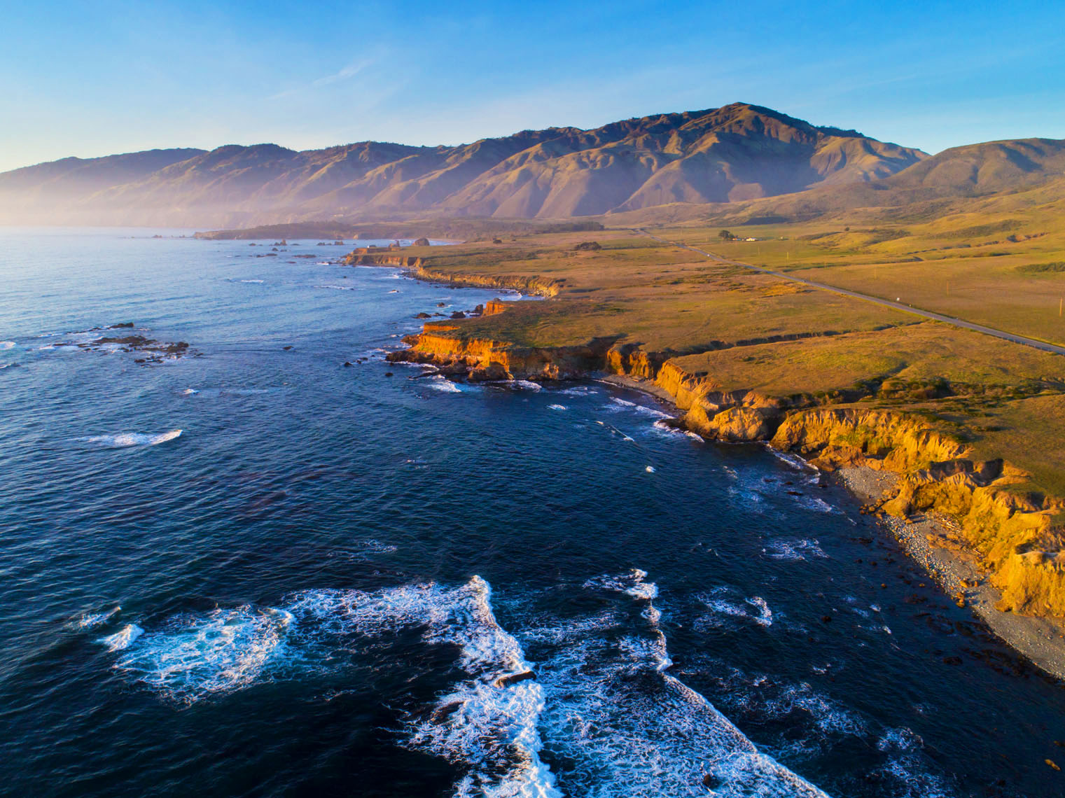 High altitude aerial of coast shows greater range of sea cliffs