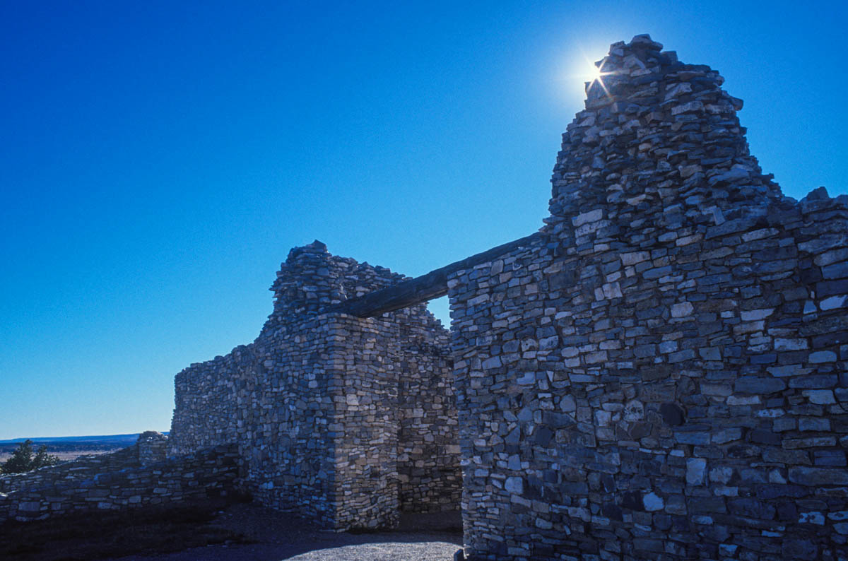 The sun is placed on the edge of the ruins of a Spanish Mission