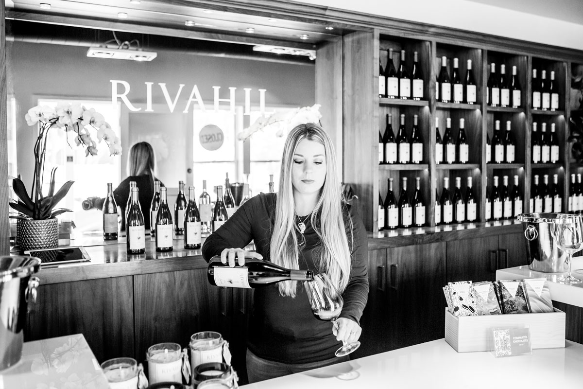 Black and white of hostess in a wine tasting room in Los Olivos