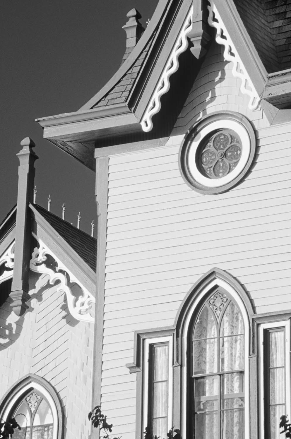 Black and white photograph of the details of a Victorian church