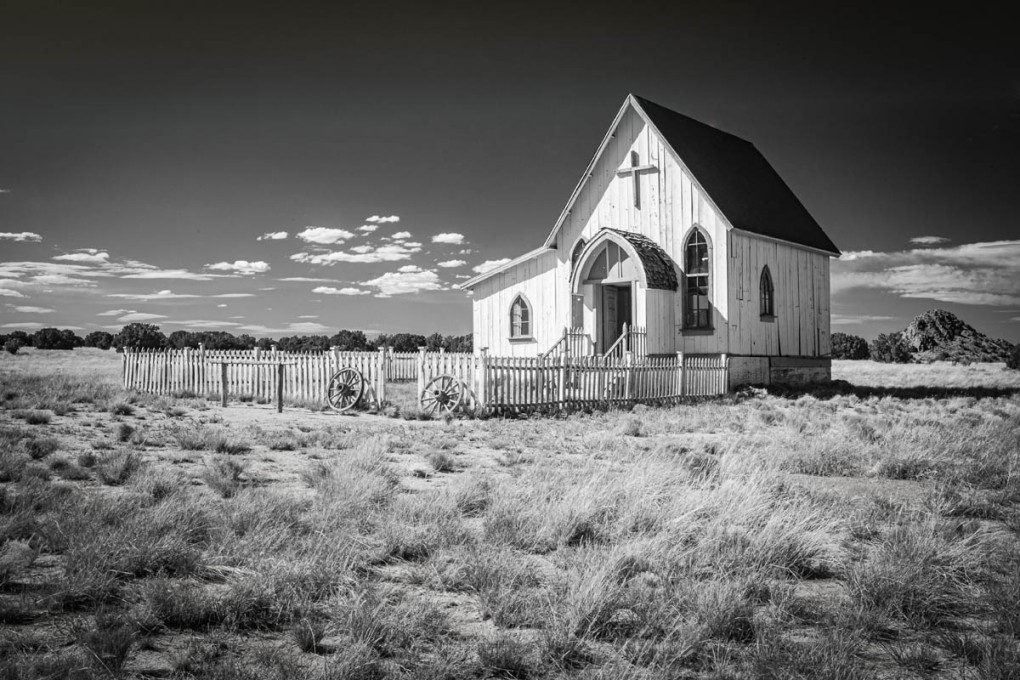 Black and white photograph of solitary church in the West