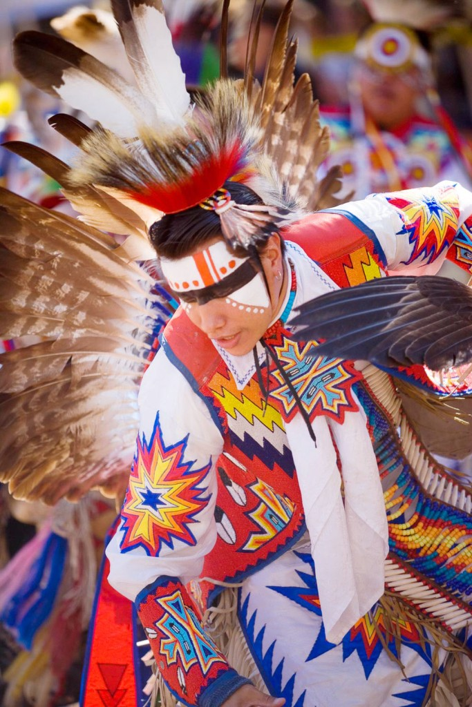 Powwow dancer photographed with shallow depth of field