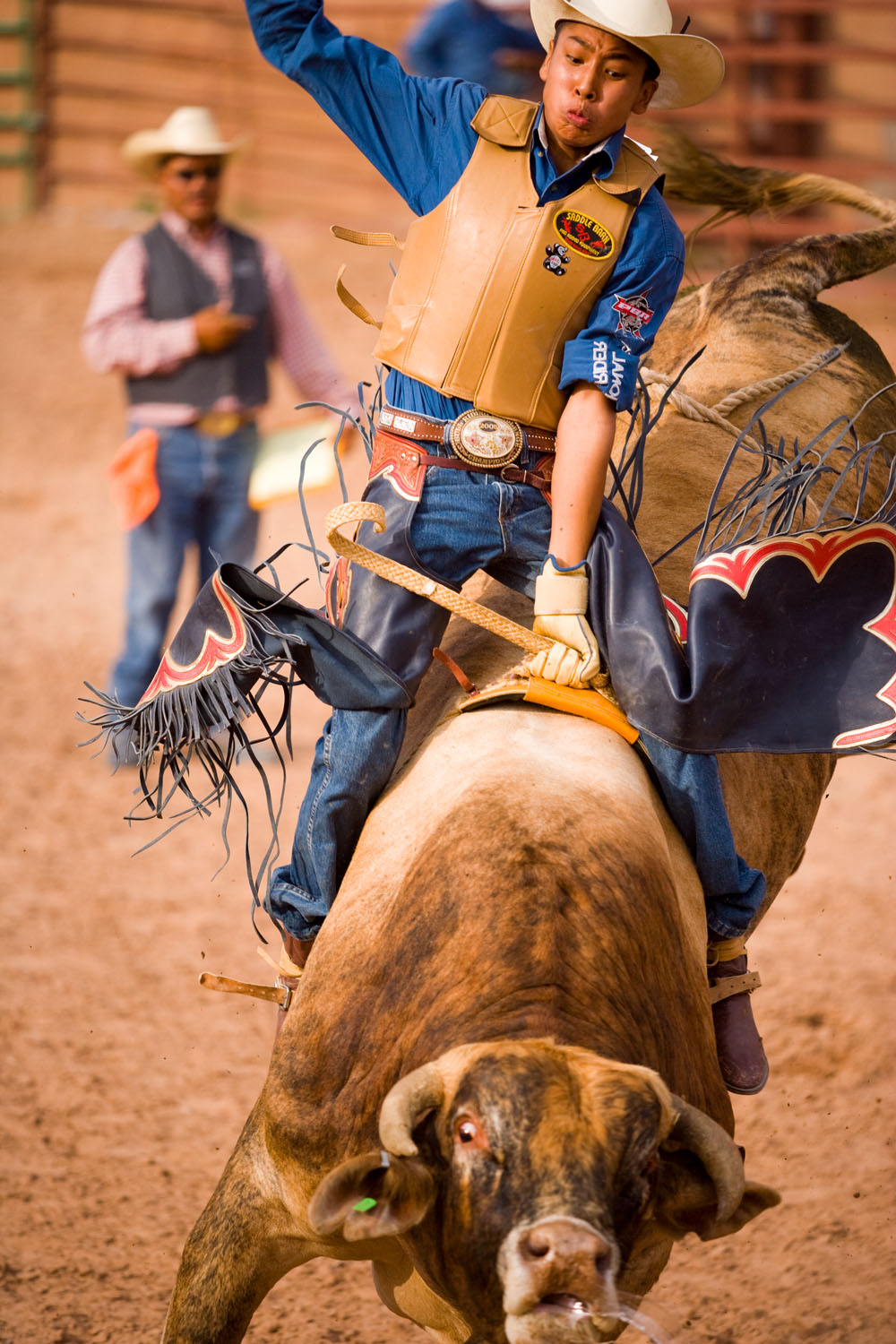 Bull rider in a rodeo captured with 300mm lens